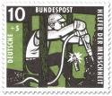 Briefmarke: Bergarbeiter im Schacht mit Abbauhammer