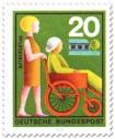 Briefmarke: Pflegehilfe: Frau im Rollstuhl