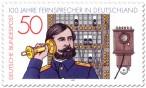 Briefmarke: Altes Telefon (Fernsprecher) und Vermittlungsbeamter