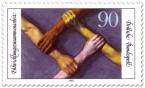 Briefmarke: Hände greifen Arme - Entwicklungszusammenarbeit