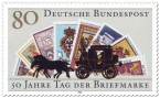 Briefmarke: Postkutsche vor Briefmarken (Tag der Briefmarke)