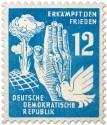Briefmarke: Atompilz, Hand und Taube